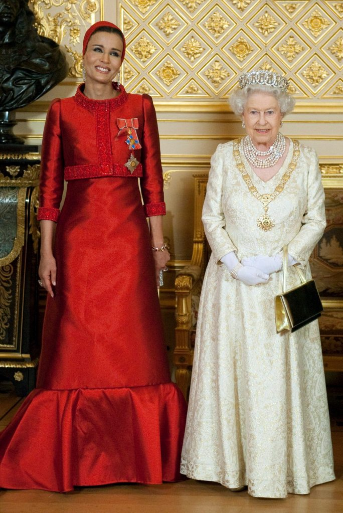 WINDSOR, UNITED KINGDOM - OCTOBER 26: Queen Elizabeth II (R) poses with Sheikha Mozah bint Nasser Al Missned, the wife of Qatar's Emir Sheikh Hamad bin Khalifa al Thani, before a banquet held during their state visit at Windsor Castle on October 26, 2010 in Windsor, United Kingdom. (Photo by Kieran Doherty - WPA Wire/Getty Images)
