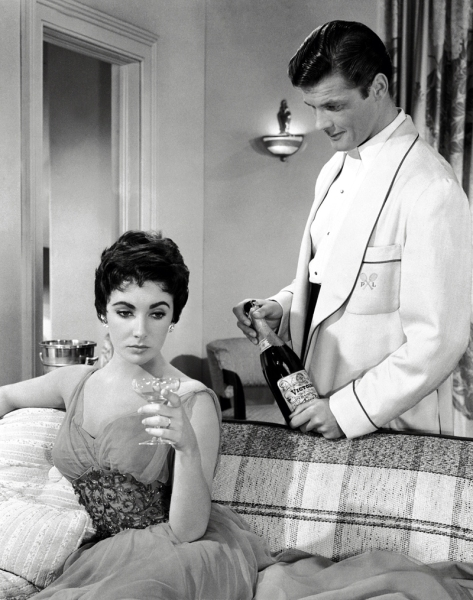 Elizabeth Taylor y Roger Moore