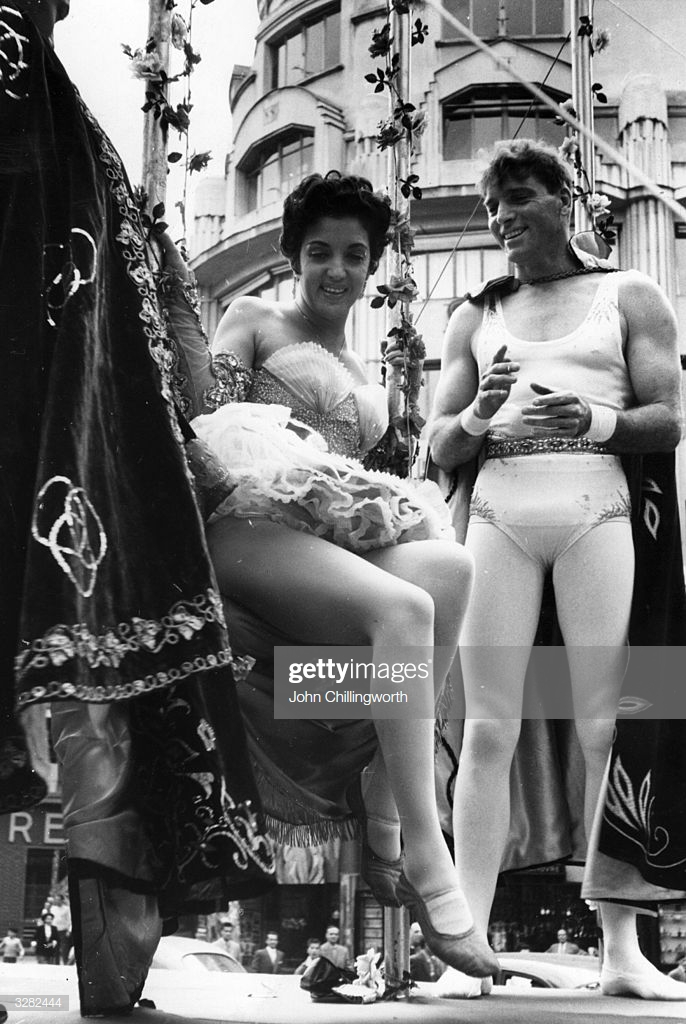 burt-lancaster-and-katy-jurado-taking-part-in-a-circus-parade-through-picture-id3282444