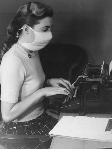 typist-in-office-wearing-surgical-mask-as-a-prophylactic-measure-during-influenza-outbreak_a-G-3598199-4990880