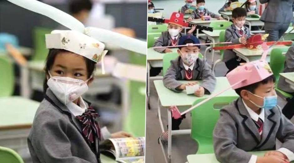 Chinese-students-wearing-social-distancing-hats-1